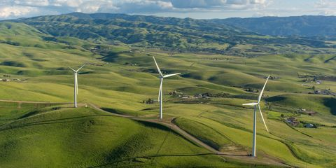 Highland, Wind farm, Wind turbine, Windmill, Wind, Mountainous landforms, Grassland, Hill, Sky, Land lot,