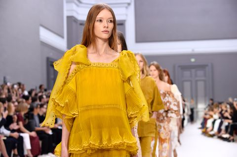 Fashion model, Fashion, Fashion show, Yellow, Clothing, Runway, Fashion design, Outerwear, Event, Haute couture,