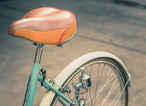 Bicycle part, Bicycle, Bicycle wheel, Bicycle saddle, Orange, Vehicle, Bicycle accessory, Pink, Mode of transport, Bicycle tire,