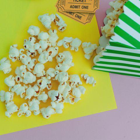 Movie tickets with pop corn