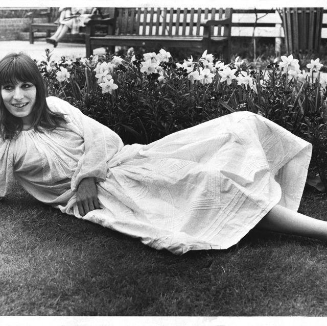 Photograph, Black-and-white, Snapshot, Photography, Sitting, Monochrome photography, Leg, Grass, Stock photography, Dress,