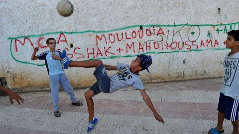 topshot   algerian children play football in the street in the bab el oued neighbourhood, which is historically known to be predominantly supporting mouloudia club alger mca football team in algiers on october 11, 2016, two days ahead of the 100th derby match against their rival union sportive medina dalger usma
