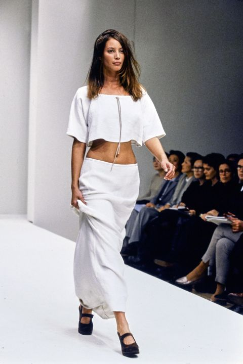 Fashion model, Fashion show, Fashion, Runway, White, Clothing, Shoulder, Waist, Beauty, Joint,