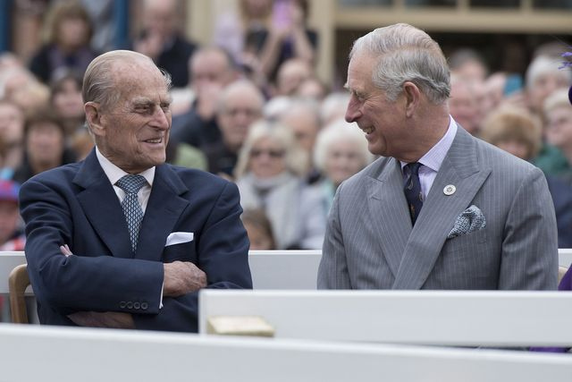 poundbury, england   october 27 britains prince philip, duke of edinburgh l and prince charles, prince of wales r listen to speeches before a statue of the queen elizabeth, the queen mother was unveiled on october 27, 2016 in poundbury, england the queen and the duke of edinburgh, accompanied by the prince of wales and the duchess of cornwall, visited poundbury poundbury is an experimental new town on the outskirts of dorchester in southwest england designed by leon krier with traditional urban principles championed by the prince of wales and built on land owned by the duchy of cornwallphoto by justin tallis   wpa poolgetty images