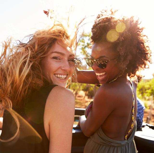 two friends in smiling in sunlight