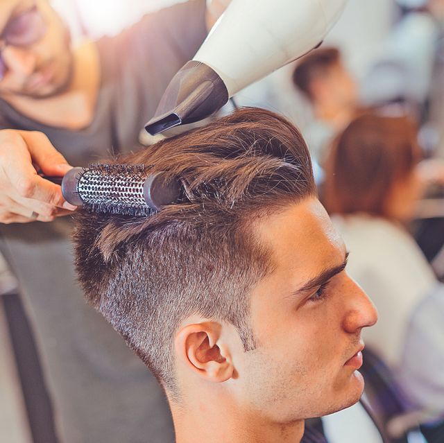 attractive male in hair dressing stuido, 20 29 yrs old, with modern hairstyle