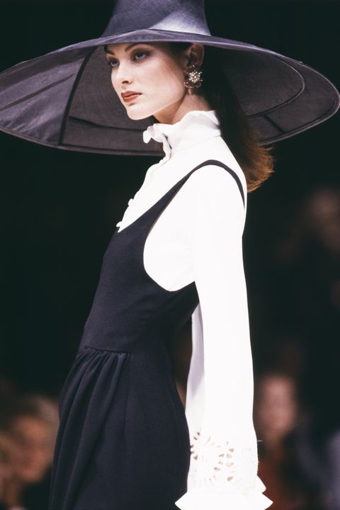 Fashion model, Fashion, Clothing, Beauty, Model, Shoulder, Runway, Dress, Fashion design, Hat,