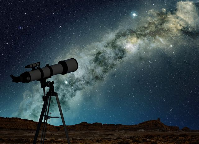 telescope pointing to the bright milky way
