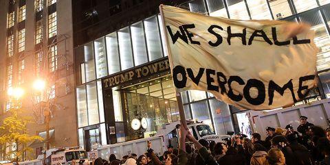 People, Crowd, Metropolitan area, Protest, Metropolis, Public event, Downtown, Banner, Rebellion, Commercial building,