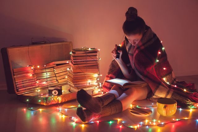 well read girl at cozy home night exciting reading