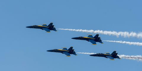 Blue Angels F/A-18 Hornets are flying The Diamond Roll (four