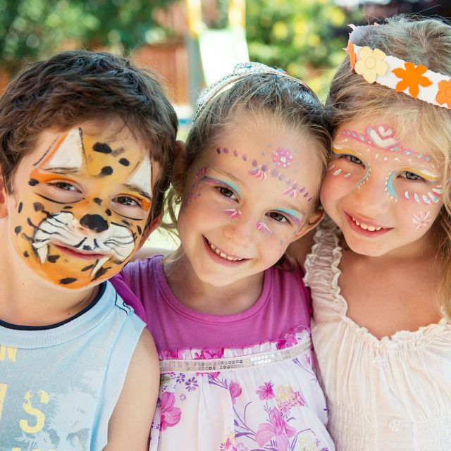 horizontal image of 3 friends with painted faces at kids party