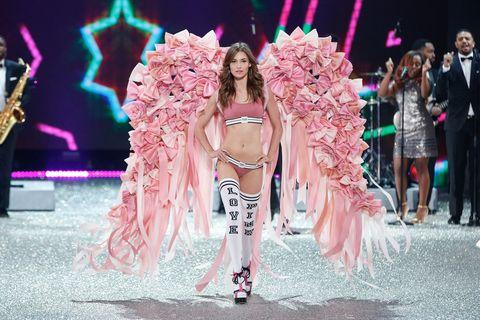 Pink, Fashion model, Fashion, Fashion show, Runway, Performance, Event, Fashion design, Performance art, Model,