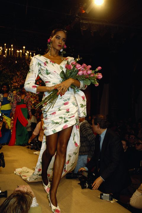 a fashion model wears a floral print cocktail dress with a long train by french fashion designer yves saint laurent at his spring summer 1987 fashion show in paris saint laurent presented his women's haute couture collection at the show photo by pierre vautheysygmasygma via getty images