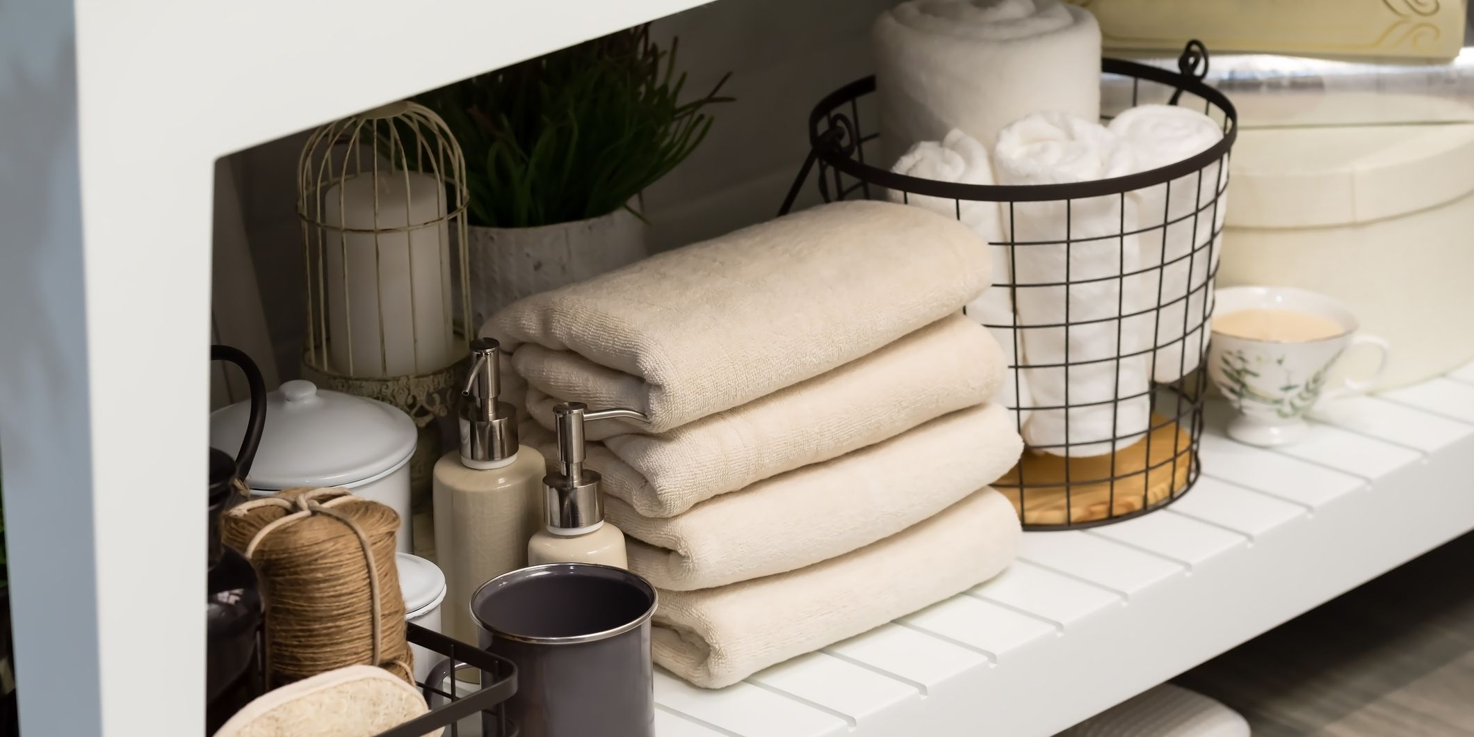 folded cotton towel under white marble bathroom marble counter