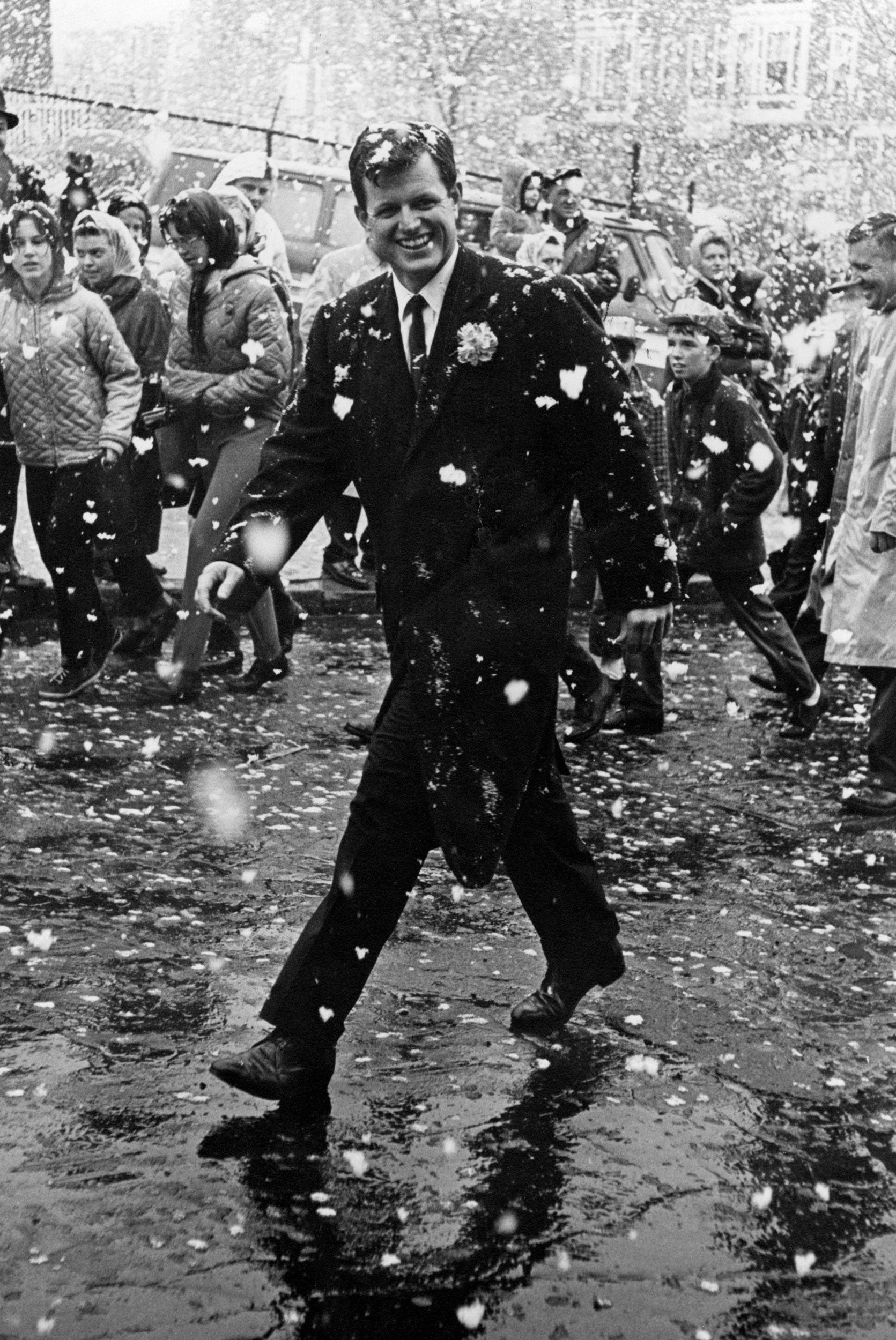 Undaunted by giant snowflakes, Senator Edward M. Kennedy marches in Southie's annual St. Patrick's Day parade in South Boston on March 17, 1964.
