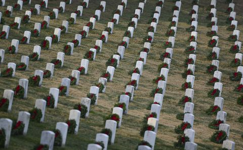 WASHINGTON, DC - DECEMBER 17: More than 50,000 anticipated volunteers placed remembrance wreaths on the nearly 245,000 headstones in Arlington National Cemetery on December 17, 2016 in Arlington, Virginia. The year 2016 marks the 25th year that wreaths have been placed in remembrance of those who have fought for the country's freedoms.