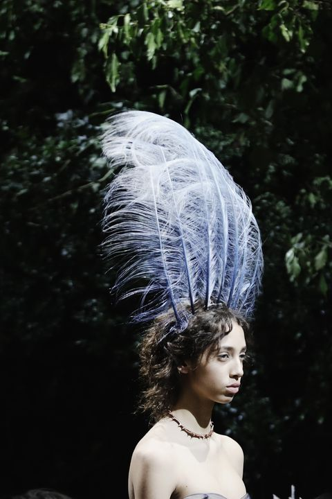 Hairstyle, Headgear, Feather, Headpiece, Jewellery, Natural material, Tradition, Portrait photography, Animal product, Hair accessory,