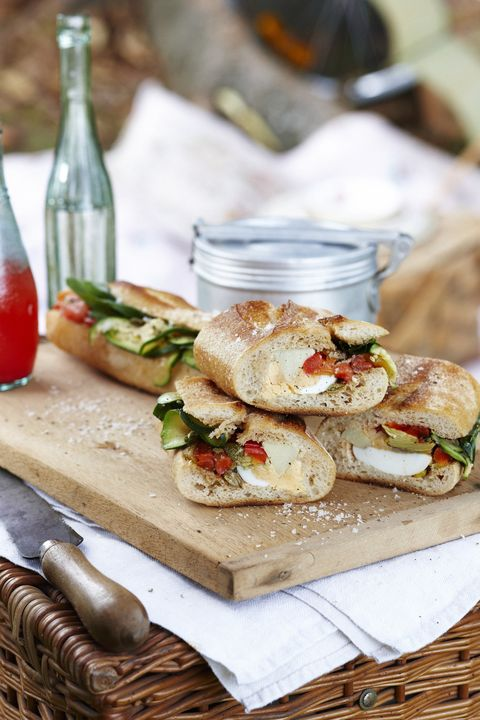 Vegetable pan bagna on cutting board and picnic basket