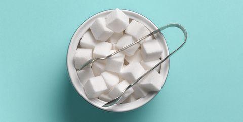 sugar cubes in sugar bowl