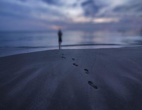 woman silhouette walking on beach sunset thailand 2016