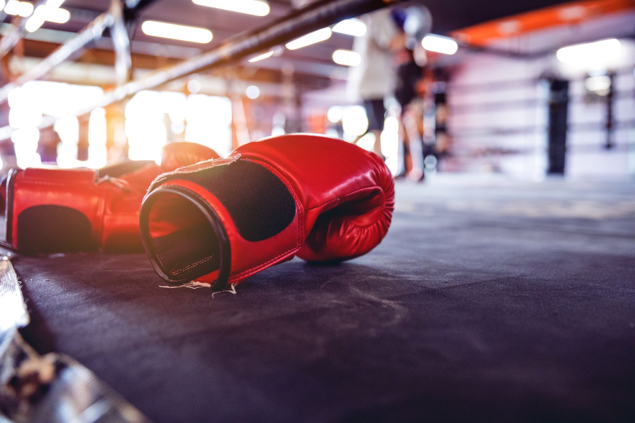 Boxing gloves on floor of ring