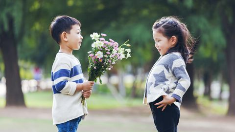 boy giving flowers to girl