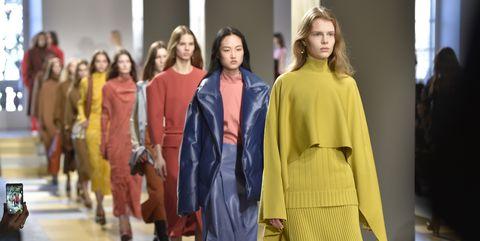 Fashion, Fashion model, Clothing, Yellow, Fashion show, Outerwear, Runway, Fashion design, Event, Street fashion,