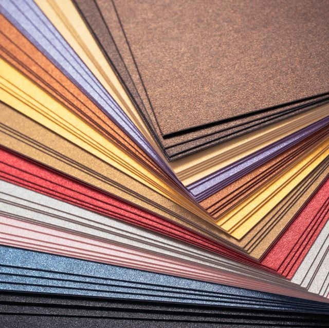 Multi Colored Background of Paper Pile