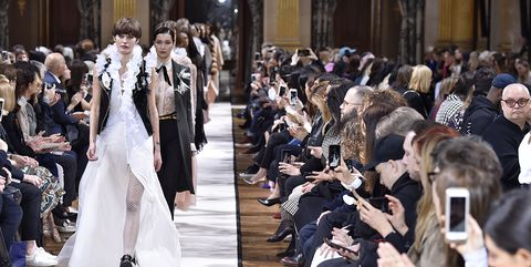 Event, Trousers, Outerwear, Dress, Formal wear, Mobile phone, Suit, Gown, Runway, Fashion show,