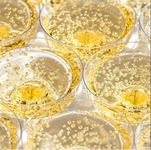 Glasses with bubbling champagne at a wedding