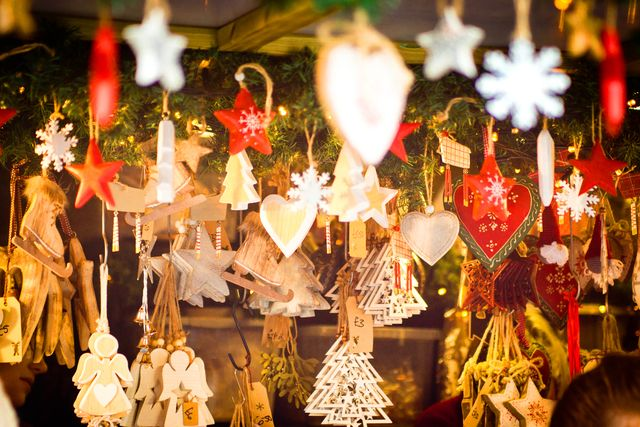 shaped hanging ornaments to act as christmas decorations on sale at lincoln christmas market they are in the shape of stars, christmas trees, angels and hearts