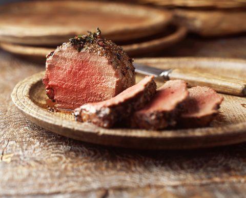 Fillet of beef on vintage wooden plate