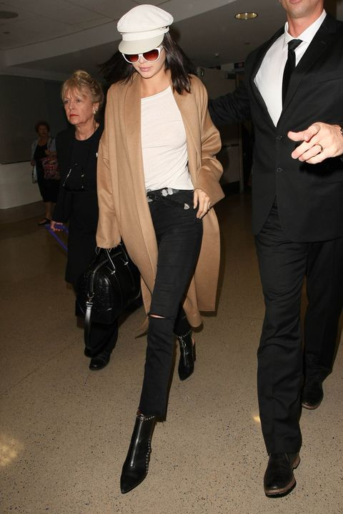 30f90c48657e4 Kendall Jenner wearing a white Greek fisherman s hat at LAX on March 13.