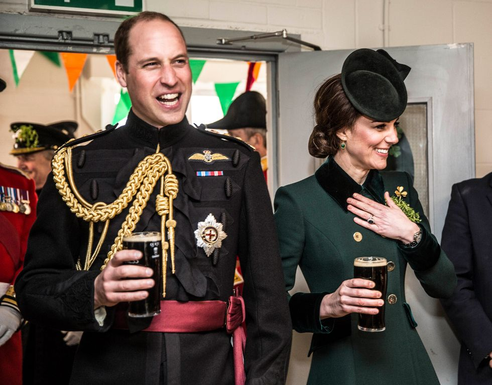 Prince William, Duke Of Cambridge and Catherine, Duchess of Cambridge, take a drink of Guinness as they meet with soldiers of the 1st battalion Irish Guards in their canteen following their St. Patricks day parade at Cavalry Barracks on March 17, 2017 in London, England.