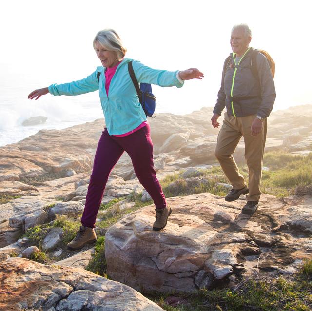 older couple hiking near the coast
