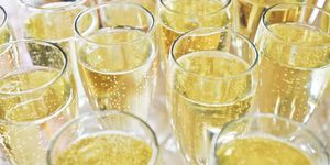 High Angle View Of Champagnes Served On Table