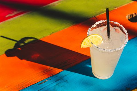 margarita glass, no people, on colorful table at mexican restaurant
