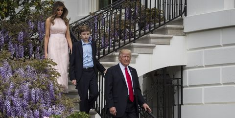 President Donald Trump with first lady Melania Trump and their son Barron Trump walk down from the Truman Balcony after speaking during the 139th Easter Egg Roll on the South Lawn of the White House in Washington, DC on Monday, April 17, 2017.
