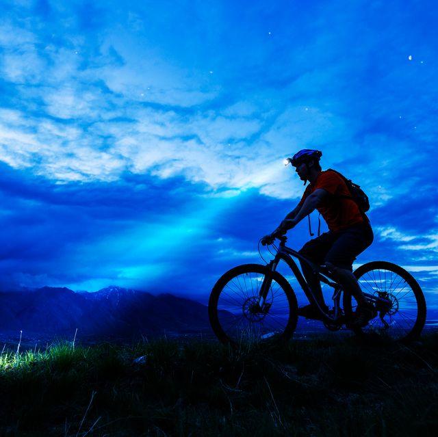 man biking with headlamp