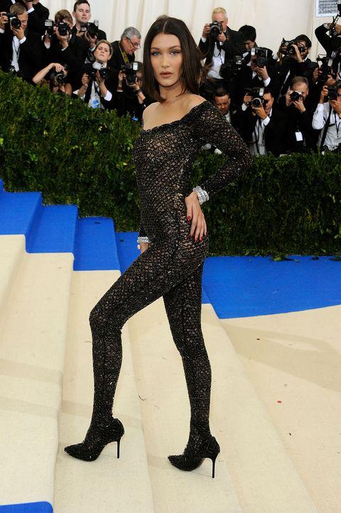 Fashion model, Fashion, Clothing, Red carpet, Shoulder, Carpet, Leg, Joint, Thigh, Flooring,