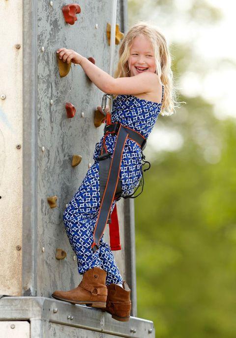 Pattern, Electric blue, Footwear, Child model, Blond, Recreation, Textile, Dress, Adventure, Jeans,