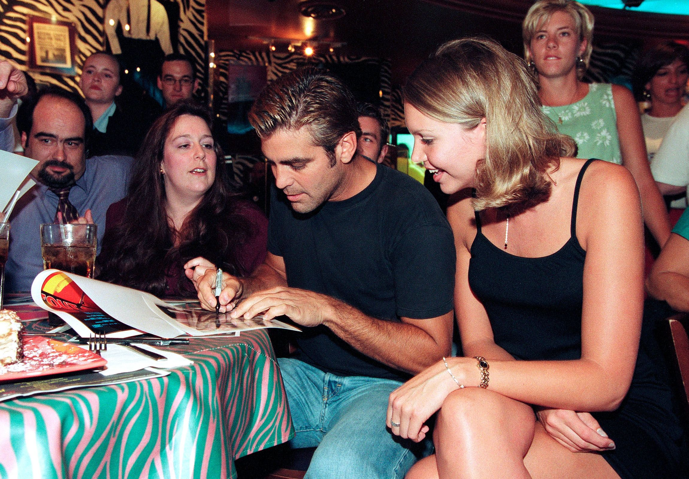 Clooney visits with fans at Planet Hollywood in 1995 in Atlanta, Georgia.
