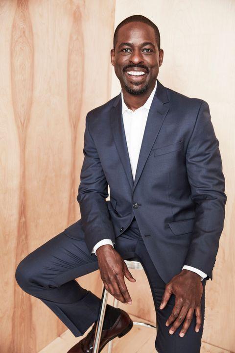 Suit, Formal wear, Tuxedo, Blazer, Outerwear, White-collar worker, Businessperson, Sitting,