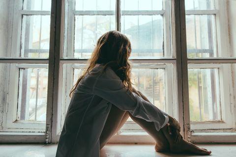 Window, Sitting, Shoulder, Long hair, Leg, Sunlight, Photography, Room, Architecture, Door,