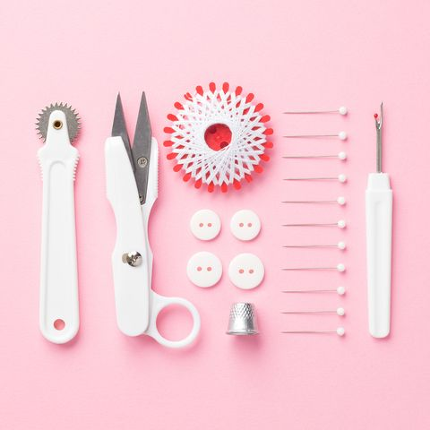 High Angle View Sewing Kit On A Pink Background