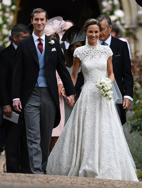 Gown, Wedding dress, Dress, Suit, Photograph, Bridal clothing, Clothing, Formal wear, Bride, Facial expression,