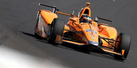Automotive design, Mode of transport, Open-wheel car, Orange, Motorsport, Automotive tire, Racing, Asphalt, Race car, Formula one,