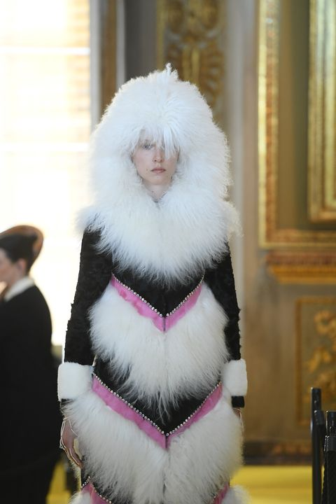 Textile, Pink, Fur clothing, Costume accessory, Natural material, Animal product, Fur, Street fashion, Costume, Glass bottle,