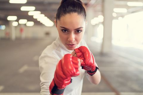 Boxing glove, Boxing, Boxing equipment, Glove, Lip, Punch, Hand, Striking combat sports, Finger, Photography,